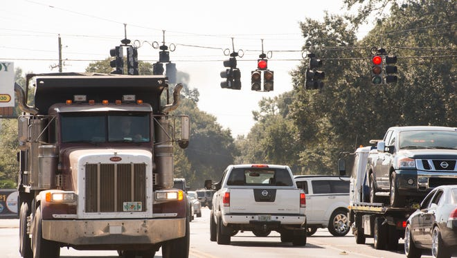 Traffic at the intersection of Chumuckla Highway and Woodbine Road in Pace on Tuesday. A new Publix is to be built across from Stonebrook Village with entrances off both Chumuckla Highway and Woodbine Road.
