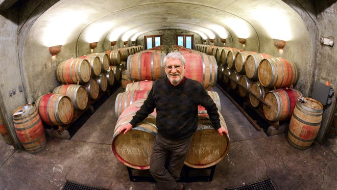 David Adelsheim stands inside the cellar at Adelsheim Vineyard in 2015 in Newberg. Adelsheim is among the vineyards and wineries that will be open over Thanksgiving weekend.