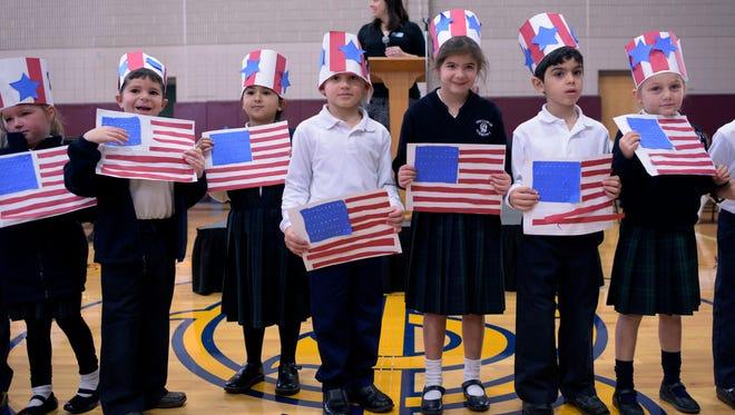 """Kindergarten students sing """"We Love Veterans."""""""