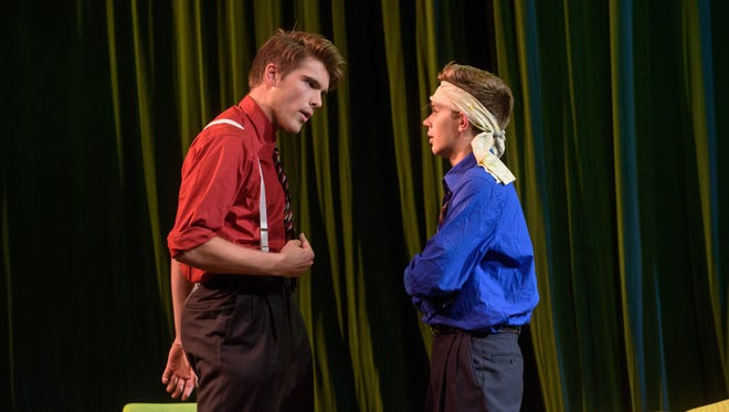 """Logan Groh (left) and Josh Verish act in the absurdist play """"Rhinoceros"""" at Greendale High School.  Drama teacher Eric Christiansen selected the play as socially relevant to the election for its themes on conformity and mob mentality."""