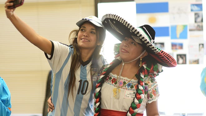 Erika Balzaretti of Argentina and Alma Vara of Mexico take a selfie together.