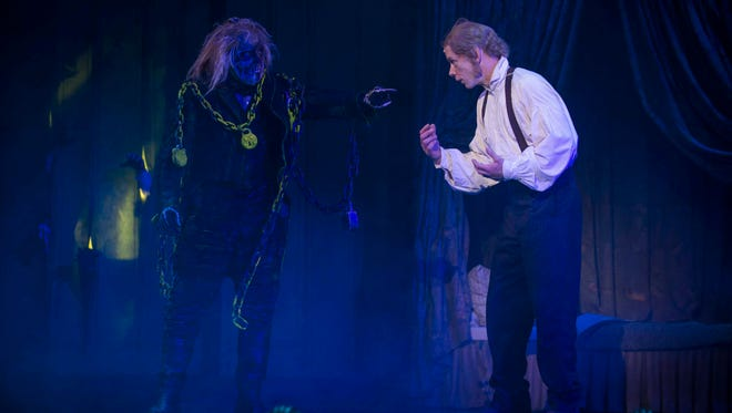 "As Scrooge, Jonathan Wainwright (right) meets the Ghost of his former partner, Jacob Marley (Jonathan Smoots), in ""A Christmas Carol."""