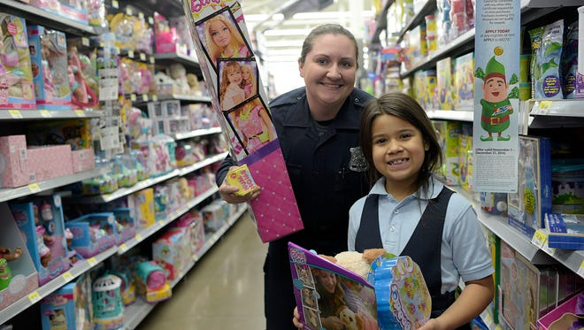 Redford police officer Michelle Crandall poses for a photo with Annbella Gonzalez, 7.