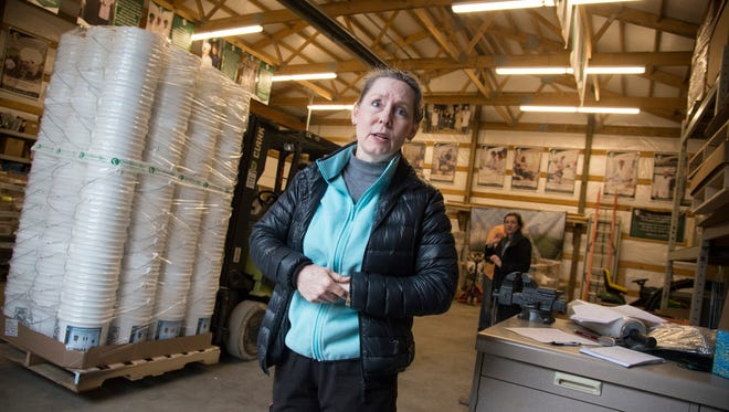Heidi Linton oversees the loading of the latest shipment of building supplies and medical equipment bound for North Korea.