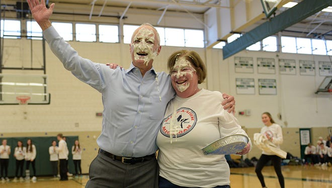 Superintendent Daniel Nerad and Groves principal Cathy Hurley wore the pie well.