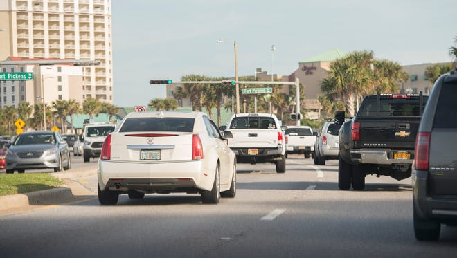 Traffic continues along Pensacola Beach Boulevard on Feb. 20, 2017.