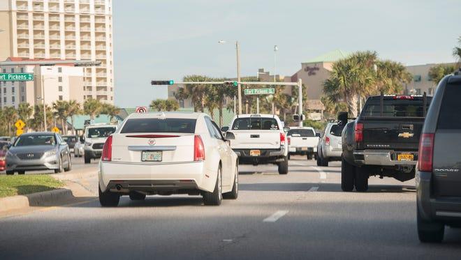 Traffic continues along Pensacola Beach Boulevard on Feb. 20, 2017.