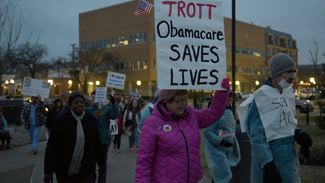 Barb Spiece of Waterford shows her support of the ACA during a rally.