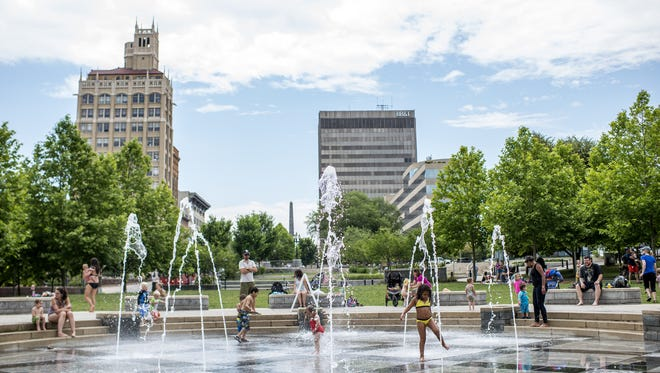 Kids play at Splasheville in Pack Square Park in downtown Asheville in 2015. When school out, the public fountain park highly popular.