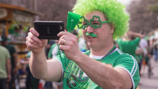 Eric Wright takes a picture of his Tyler Park Neighborhood Association friends before last year's St. Patrick's Day parade in Louisville.
