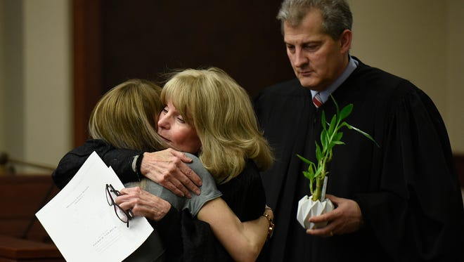 Judge Kathleen McCann of Livonia's 16th District Court, shown here hugging a graduate of the recent sobriety court program, said she's personally witnessed the horrors of opioid abuse in her community. She sits on new FAN chapter advisory board.