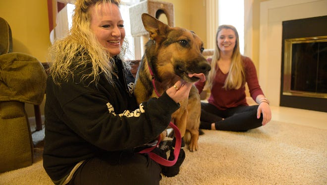Heather Ineich, left, and her neighbor Cailin Gallagher pose for a photo with Murphy.