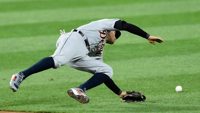Tigers' Ian Kinsler is unable to field the two-run single by Twins' Robbie Grossman during the sixth inning.