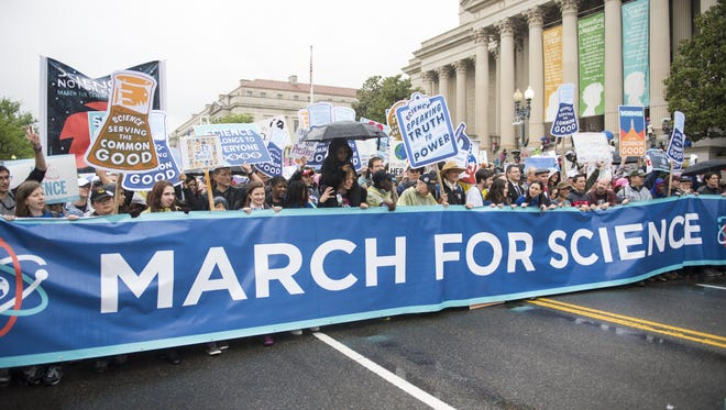 Marchers carry a banner at the head of the April 22 March for Science rally in Washington.