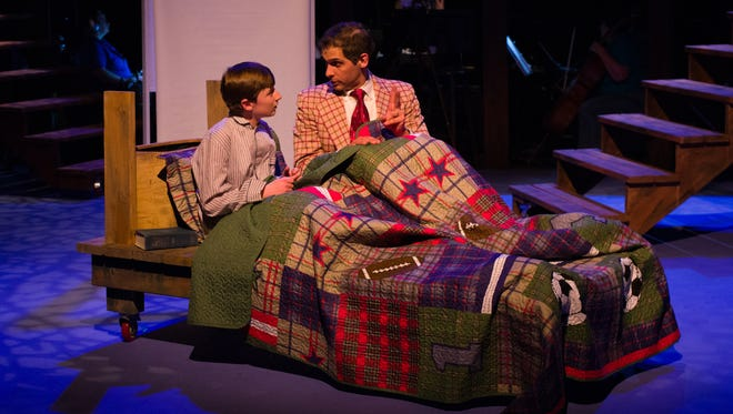 Young Will (Julian Mudge-Burns, left) is skeptical of a bedtime story told by his father, Edward Bloom (Jason Gingold).