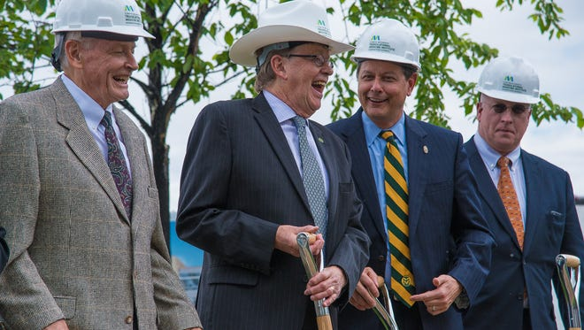 Dr. Wayne McIlwraith, second from left, participates in a groundbreaking ceremony for the C. Wayne McIlwraith Translational Medicine Institute, a $65 million research facility on the CSU campus, on Friday, June 2, 2017.