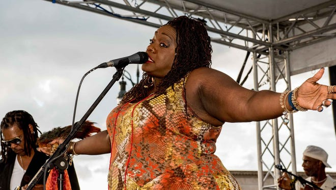 Thornetta Davis and the Thornetta Davis band perform during the grand opening of Beacon Park in Detroit on July 20, 2017.