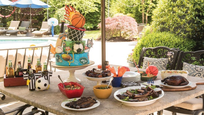 Main Dish and In Good Spirits with a backyard sports theme. Featuring food from Smoked in Ridgewood; Cake from Vanessa Greeley in Glen Rock; Beverages and staging /styling provided by Deirdre Ward on Thursday June 01, 2017.