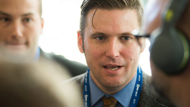 Richard Spencer takes questions at CPAC from reporters, before he was removed from the convention on Feb. 23, 2017, during the Conservative Political Action Conference at the Gaylord National Resort and Convention Center in National Harbor, Md.