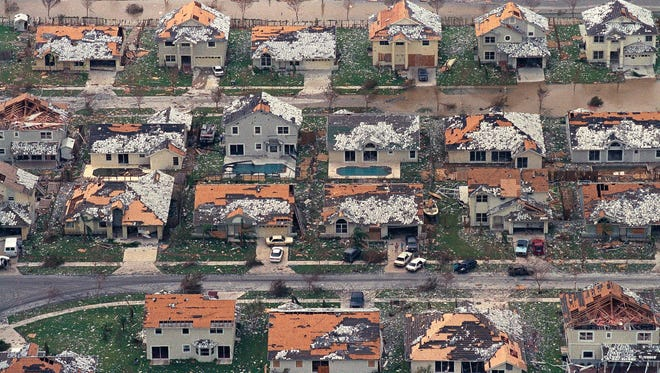 Rows of damaged houses between Homestead and Florida City, Fla., in the hours after Hurricane Andrew tore through the area on Aug. 24, 1992.