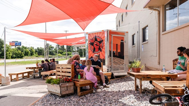 The dining area at Street Kitchen, a new food trailer on the east side of 2722 E. Michigan Avenue in Lansing Township.  [Matthew Dae Smith/Lansing State Journal]