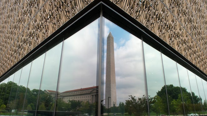 The Washington Monument and Herbert C. Hoover Federal Building are reflected in the windows of the National Museum of African American History and Culture.  September 24th is the first anniversary of the National Museum of African American History and Culture opening its doors.