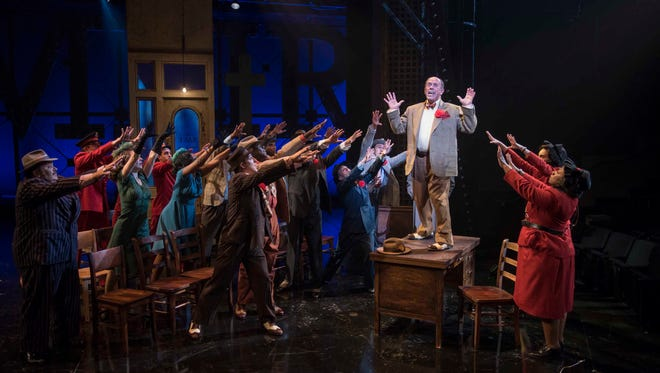 """Michael J. Farina testifies in Milwaukee Repertory Theater's production of """"Guys and Dolls."""" It runs through Oct. 29 at the Rep's Quadracci Powerhouse, 108 E. Wells St."""