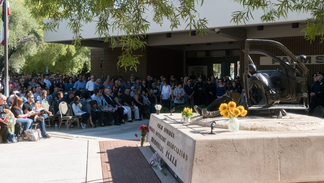 Hundreds attend a ceremony to add the names of Officers Jose 'Gil' Vega and Lesley Zerebny to the memorial for fallen officers at the Palm Springs Police Department, Sunday, October 8, 2017.