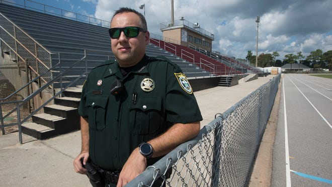 Santa Rosa County Sheriff Deputy and School Resource Officer, Arthur Austin patrols the campus of Navarre High School Wednesday, Oct. 11, 2017. The Santa Rosa School District and the sheriff's office have entered and agreement to add resource officers at the county's middle schools.