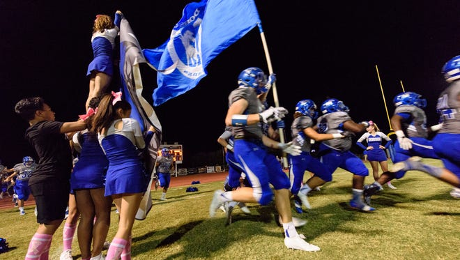 Dobson players take the field before their high school football game against Mountain View on Friday, Oct.13, 2017, at Dobson High School in Mesa, Ariz.