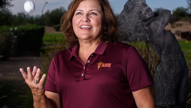 ASU Women's Golf coach Missy Farr-Kaye stands in front of the statue of her sister Heather Farr on the 10th Hole at ASU Karsten Golf Course, on Wednesday Nov. 8, 2017, in Tempe, Arizona.