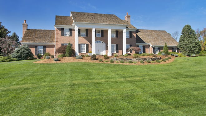 This six-bedroom home in Green Township sits on 44 subdividable acres. It's offered at $2.4 million.