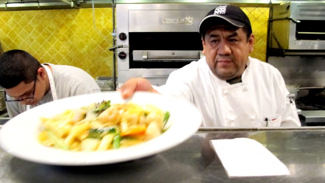 Executive Chef Hector Hidalgo, shown at work in November 2015 in the kitchen of Fish Crazy Restaurant in North Naples, will be back in December 2017 as the chef at a new local restaurant, Naples Coastal Kitchen.
