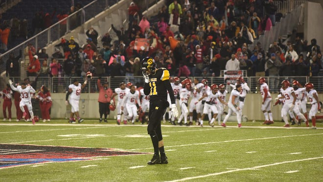 Tri-Valley's Jake McLoughlin walks off the field after the Scotties were intercepted in the final seconds of the Division III state finals.