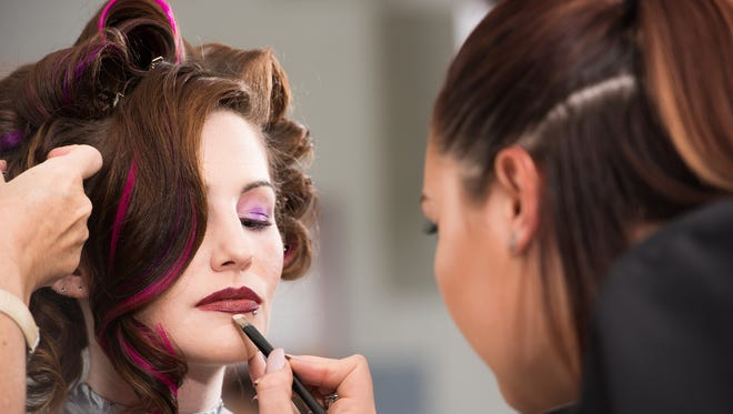 RVCC Cosmetology student Kiera Copperthwaite works on hair and makeup for student model Rebecca Reilly.