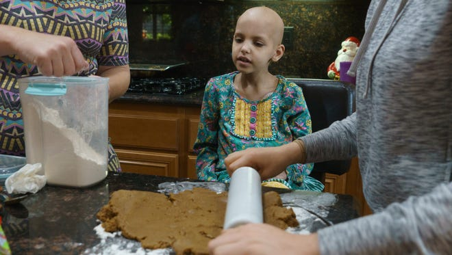 Riley Rose Sherman makes cookies with her mother and cousin in La Quinta, Calif., December 17, 2017. The Shermans approached life with hope and positivity during Riley's battle with neuroblastoma. Riley died April 13, 2018. She was 6 years old.