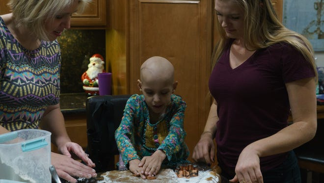 Riley Rose Sherman makes cookies with her mother and cousin in La Quinta, Calif., December 17, 2017.  The Shermans have approached life with hope and positivity since Riley was diagnosed with neuroblastoma 17 months ago.