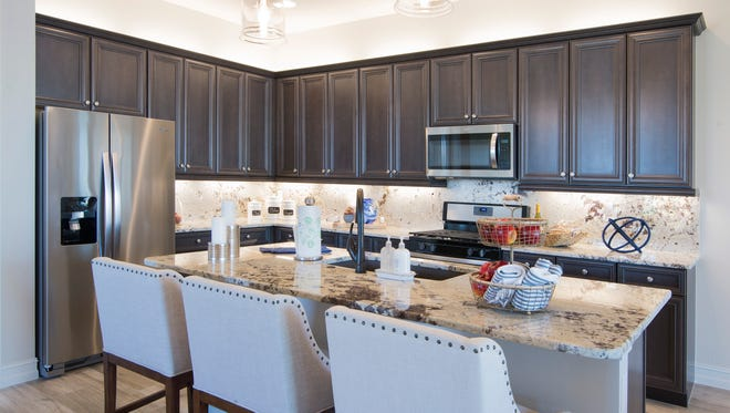 The Bella model at Zuckerman Homes' Venetian Pointe features a large island counter with sink and breakfast bar.