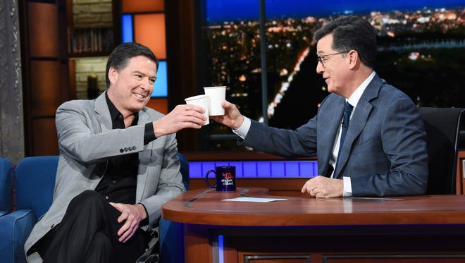 """Former FBI director James Comey (left) with host Stephen Colbert (right) on """"The Late Show with Stephen Colbert,"""""""