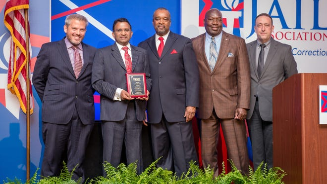 Chaplain John Spurgeon, center, of the Rutherford County Adult Detention Center, was honored as American Jail Association Volunteer of the Year. From left are award sponsor Bob Barker Jr. of Bob Barker Co., Spurgeon, AJA President Ronaldo Myers, Rutherford County Deputy Chief Bernard Salandy and Sgt. David Hutsell of the Rutherford County Adult Detention Center.