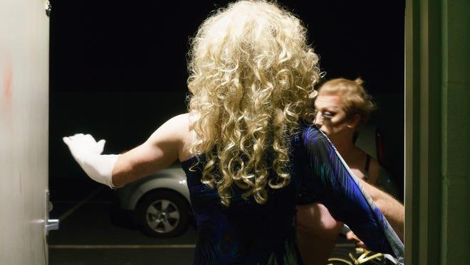 Marina Mac sprays perfume on Robert Hopwood, performing as Sandi Ego, before his first drag performance at Copa Nightclub in Palm Springs, Calif., March 29, 2018.