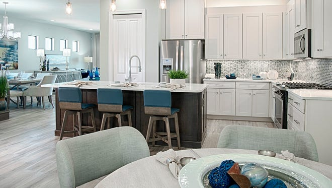The Dolce model features a kitchen with a cafe and breakfast bar.
