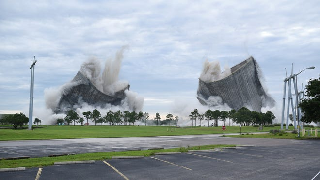 Two 464-foot-tall cooling towers of the St. Johns River Power Park on Jacksonville, Florida's Northside are simultaneously imploded Saturday, June 16, 2018, as part of the demolition of the now closed coal fired power plant operated by the Jacksonville Electrical Authority.
