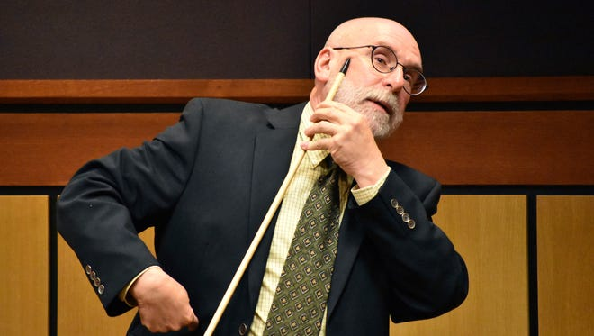 """Dr. Robert Kurtzman describes the path of one of the bullets that hit Frank """"Joey"""" Half Jr. in the cheek during Half's fatal confrontation with Billings police officers last November, in the Yellowstone County Courthouse in Billings, Mont., Thursday, June 21, 2018. Kurtzman said during an inquest examining the shootings that Half was hit seven times by bullets fired by officers. (AP Photo/Matthew Brown)"""