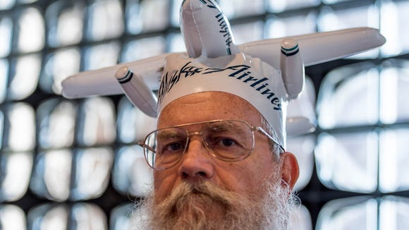 7/12/18 3:17:05 PM -- Arlington, VA  -- Milton Banas of San Antonio is a regular vendor and attendee at the Airliners International collectibles shows. His inflatable Alaska Airlines hat has become his calling card at the events. --    Photo by Camille Fine, USA TODAY Staff ORG XMIT:  CF 137303 Airline memorabi 07/12/2018 [Via MerlinFTP Drop]