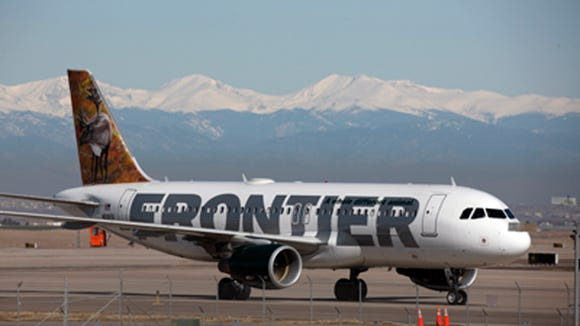 A Frontier Airlines jetliner arrives at Denver International Airport, where the airline has a hub.