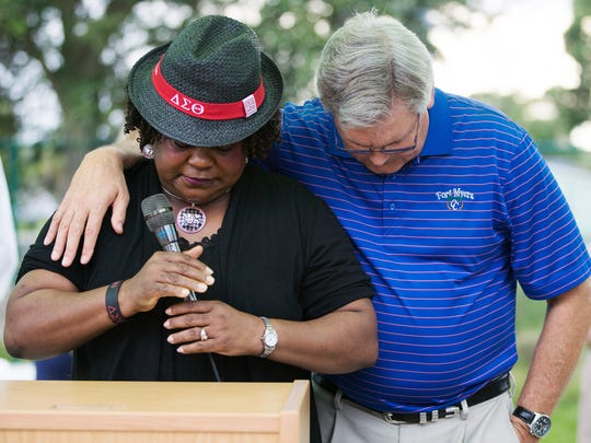 Fort Myers Councilwoman Teresa Watkins-Brown and Mayor Randy Henderson unite in prayer at a community vigil Thursday at the Quality Life Center in Fort Myers. The vigil honored those killed and injured at a teen party at the Club Blu nightclub in Fort Myers.