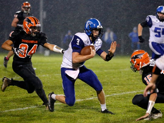 Amherst quertback Marcus Glodowski (3) has developed into one of the more dynamic players in central Wisconsin in his first season as a starting quarterback.