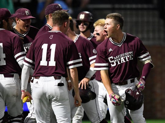 Mississippi State right fielder Elijah MacNamee (40) celebrates his three-run homer in the third inning to make the score 7-2 over Vanderbilt.