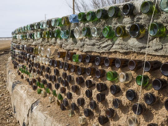 Bottles are recycled in walls of homes at the Earthship